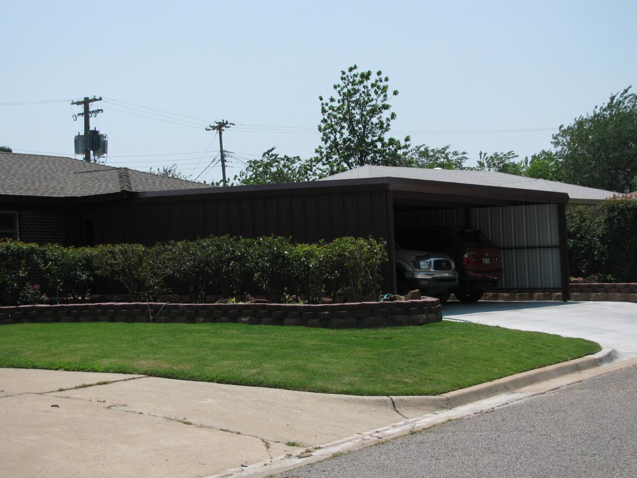 Okc carports carports metal buildings oklahoma city for Carports with sides